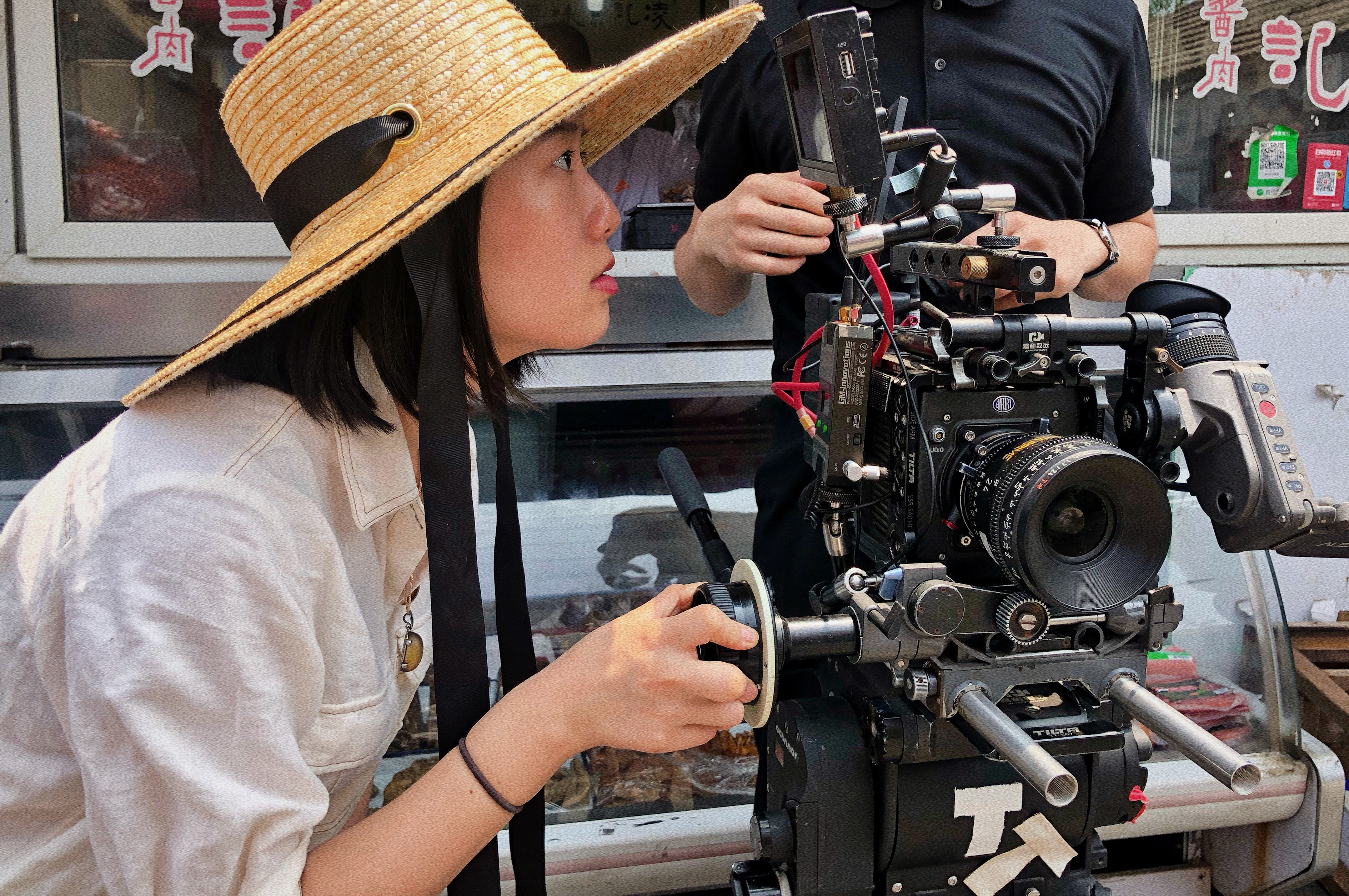 A young filmmaker behind the camera