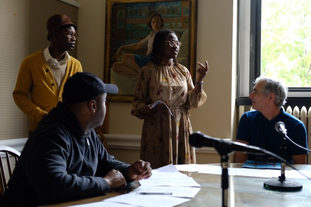 Professor Abosede George, with actors, reads from a Nigerian court case transcript.