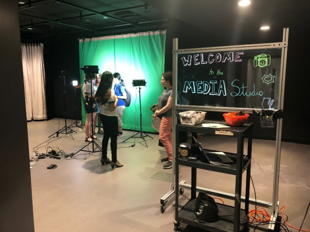 Media studio with green screen in the background