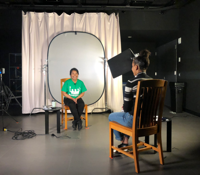 A student interviews a domestic worker in the Media Center Studio